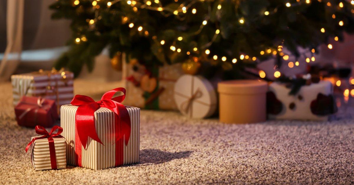 Beautiful Christmas gift boxes on floor-img (1)