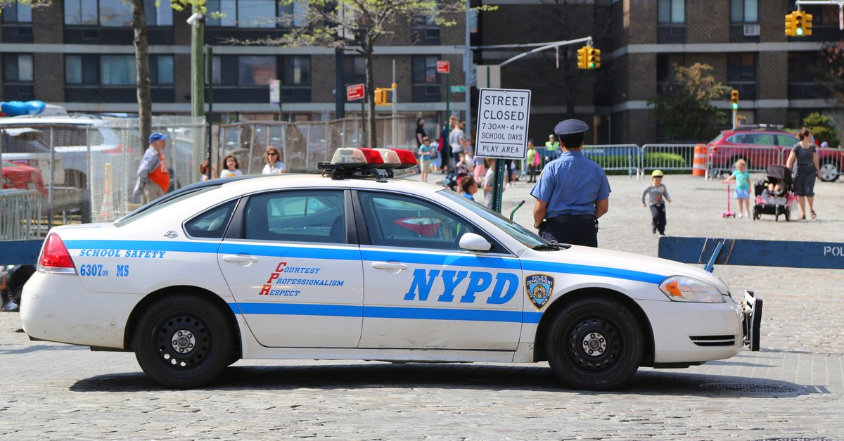 NYPD School Safety Officer in front of school-img (1)
